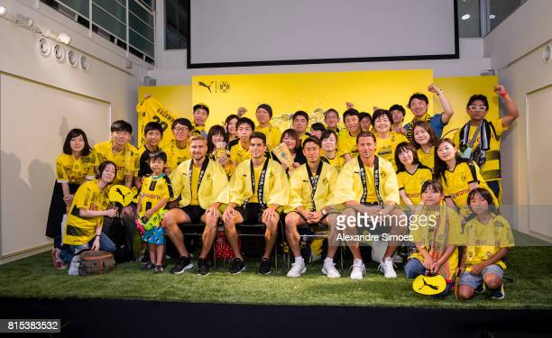 Roman Weidenfeller Marc Bartra Shinji Kagawa and Marcel Schmelzer of Borussia Dortmund together with their fans during the KAMO activity event at the...