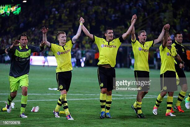 Roman Weidenfeller Marco Reus Sebastian Kehl Oliver Kirch and Mario Goetze of Dortmund celebrate the 21 victory after the Bundesliga match between...