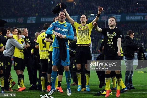 Roman Weidenfeller Neven Subotic and Jakub Blaszczykowski of Dortmund celebrate winning the German Championships after winning 21 during the 1...