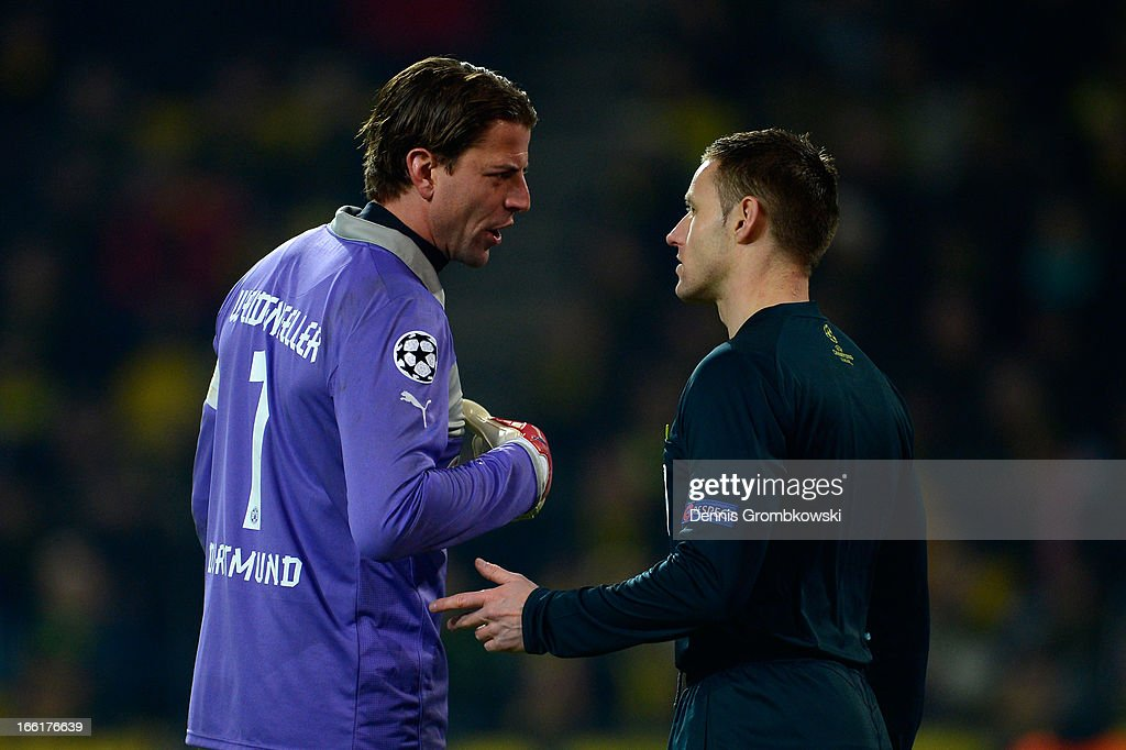 Roman Weidenfeller of Borussia Dortmund argues with a match official during the UEFA Champions League quarter-final second leg match between Borussia Dortmund and Malaga at Signal Iduna Park on April 9, 2013 in Dortmund, Germany.