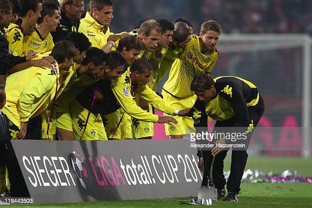 Roman Weidenfeller of Dortmund celebrates with his team mates winning the LIGA total Cup finale match between BVB Borussia Dortmund and Hamburger SV...