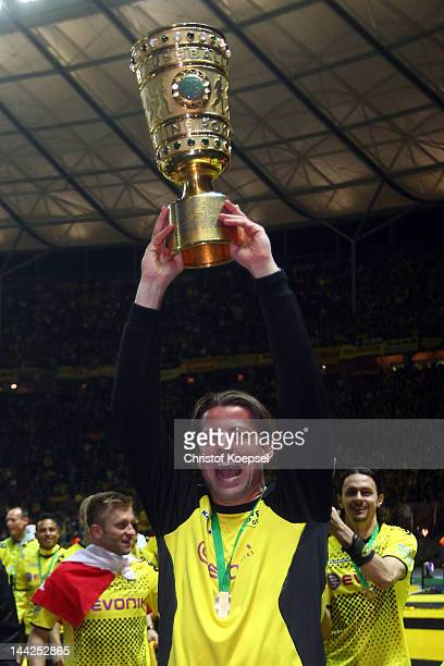 Roman Weidenfeller of Dortmund celebrates with tzhe trophy afterthe DFB Cup final match between Borussia Dortmund and FC Bayern Muenchen at Olympic...