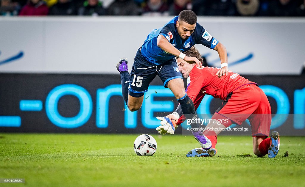 Roman Weidenfeller of Dortmund challenges Jeremy Toljan of Hoffenheim during the Bundesliga match between TSG 1899 Hoffenheim and Borussia Dortmund at Wirsol Rhein-Neckar-Arena on December 16, 2016 in Sinsheim, Germany.
