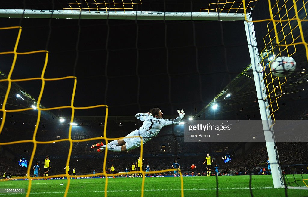 <a gi-track='captionPersonalityLinkClicked' href=/galleries/search?phrase=Roman+Weidenfeller&family=editorial&specificpeople=726753 ng-click='$event.stopPropagation()'>Roman Weidenfeller</a> of Dortmund fails to stop a shot by Hulk of Zenit as he scores the opening goal during the UEFA Champions League round of 16, second leg match between Borussia Dortmund and FC Zenit at Signal Iduna Park on March 19, 2014 in Dortmund, Germany.