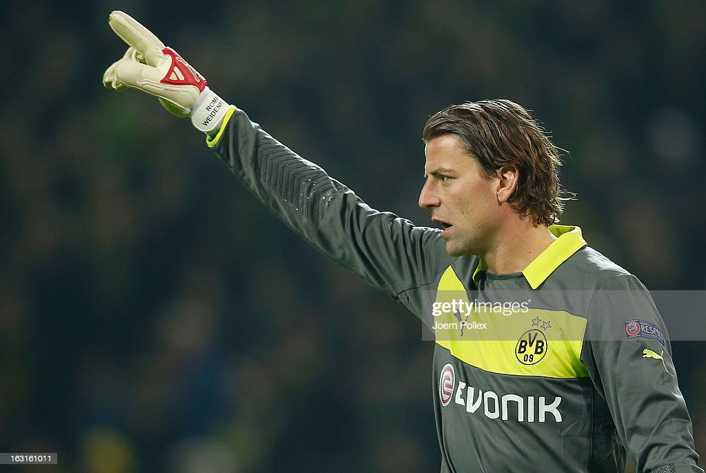 <a gi-track='captionPersonalityLinkClicked' href=/galleries/search?phrase=Roman+Weidenfeller&family=editorial&specificpeople=726753 ng-click='$event.stopPropagation()'>Roman Weidenfeller</a> of Dortmund gestures during the UEFA Champions League round of 16 leg match between Borussia Dortmund and Shakhtar Donetsk at Signal Iduna Park on March 5, 2013 in Dortmund, Germany.
