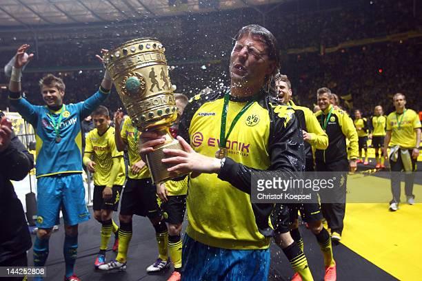 Roman Weidenfeller of Dortmund got a beer shower after winning 52 the DFB Cup final match between Borussia Dortmund and FC Bayern Muenchen at Olympic...