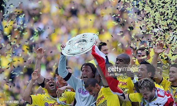 Roman Weidenfeller of Dortmund lifts the trophy after the Bundesliga match between Borussia Dortmund and Eintracht Frankfurt at Signal Iduna Park on...