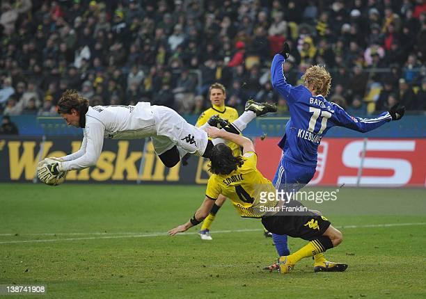Roman Weidenfeller of Dortmund makes a save from Stefan Kieflling of Leverkusen during the Bundesliga match between Borussia Dortmund and Bayer 04...