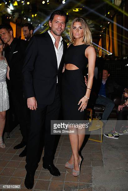 Roman Weidenfeller of Dortmund pose with his girlfriend Lisa Rossenbach during the Borussia Dortmund Champions party after the DFB Cup final 2015 at...