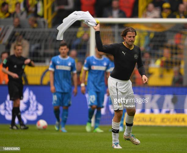 Roman Weidenfeller of Dortmund rips off his shirt in frustration after being shown the red card by referee Doctor Jochen Drees during the Bundesliga...