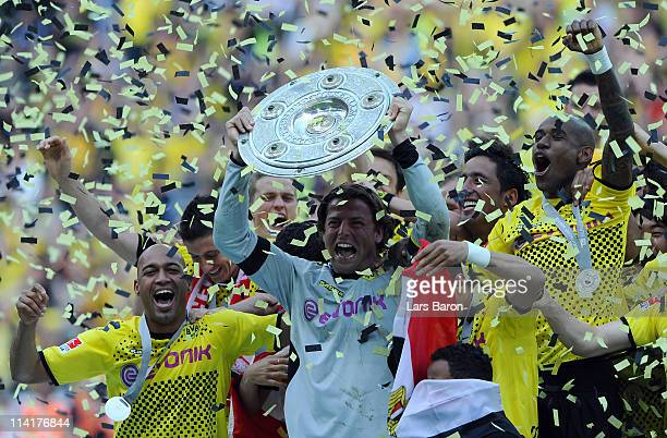 Roman Weidenfeller of Dortund lifts the trophy after the Bundesliga match between Borussia Dortmund and Eintracht Frankfurt at Signal Iduna Park on...
