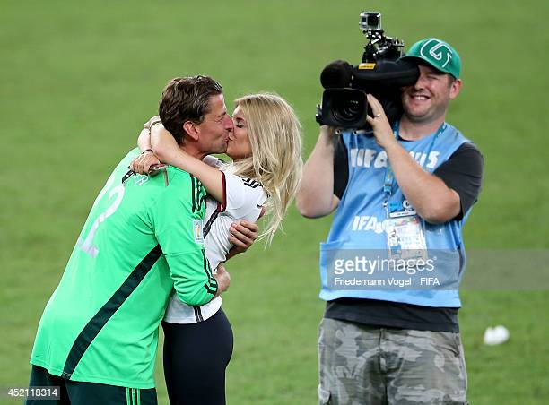 Roman Weidenfeller of Germany kisses with his wife Lisa Weidenfeller after the 2014 FIFA World Cup Brazil Final match between Germany and Argentina...
