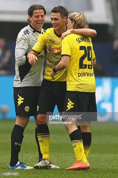 Roman Weidenfeller Sebastian Kehl and Marcel Schmelzer of Dortmund celebrate the 21 victory after the Bundesliga match between FC Schalke 04 and...