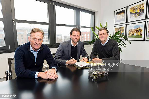 Roman Weidenfeller signs a contract extension for Borussia Dortmund with HansJoachim Watzke CEO of Borussia Dortmund and Michael Zorc sports director...