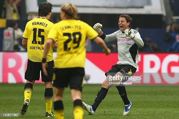 Roman Weidenfellerof Dortmund celebrates the 21 victory with Mats Hummels after the Bundesliga match between FC Schalke 04 and Borussia Dortmund at...