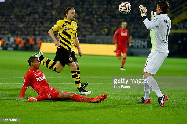 Roman Weidenfelller keeper of Dortmund safes a shot by Anthony Ujah of Koeln during the Bundesliga match between Borussia Dortmund and 1 FC Koeln at...