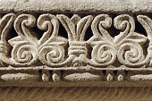 Romanesque decorations carved in the stone wall of an ancient medieval church