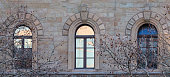 Romanesque windows on a marble house front