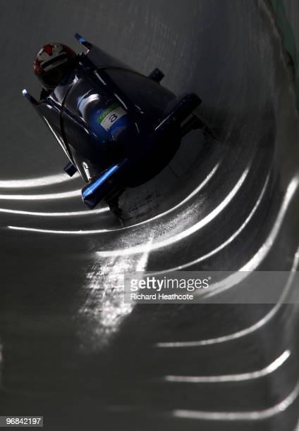 Romania 1 driven by Nicolae Istrate practices during TwoMan Bobsleigh training on day 7 of the 2010 Vancouver Winter Olympics at The Whistler Sliding...