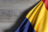 3d rendering of Romania flag waving on wooden background