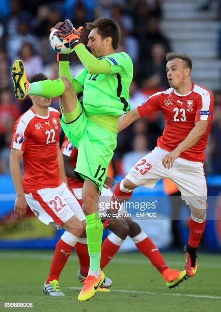 Romania goalkeeper Ciprian Tatarusanu claims the ball under pressure from Switzerland's Xherdan Shaqiri
