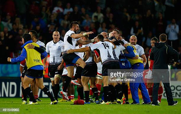 Romania players celebrate victory after the 2015 Rugby World Cup Pool D match between Canada and Romania at Leicester City Stadium on October 6 2015...