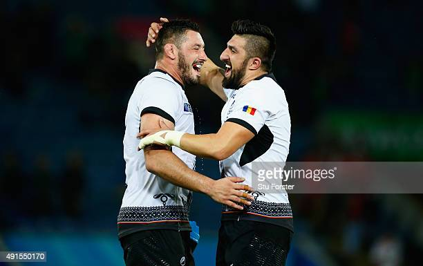 Romania players Mihai Macovei and Florin Vlaicu celebrate after their victory after the 2015 Rugby World Cup Pool D match between Canada and Romania...