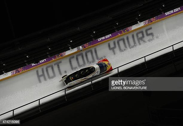 Romania1 fourman bobsleigh pilot Andreas Neagu pushman Florin Craciun pushman Paul Muntean and brakeman Danut Moldovan compete in the Bobsleigh...