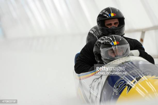 Romania1 fourman bobsleigh steered by Andreas Neagu take part in a training session at the Sanki Sliding Center in Rosa Khutor during the Sochi...
