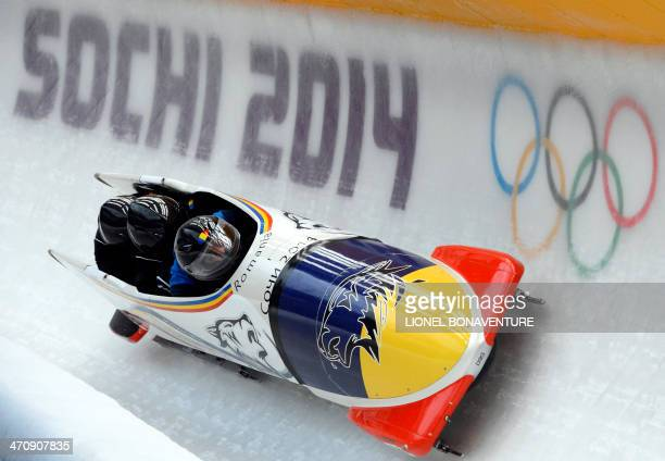 Romania1 fourman bobsleigh steered by Andreas Neagu takes part in a training session at the Sanki Sliding Center in Rosa Khutor during the Sochi...