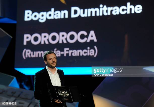 Romanian actor Bogdan Dumitrache holds his 'Concha de Plata' best actor award for his role in the film 'Pororocca' during the 65th San Sebastian Film...