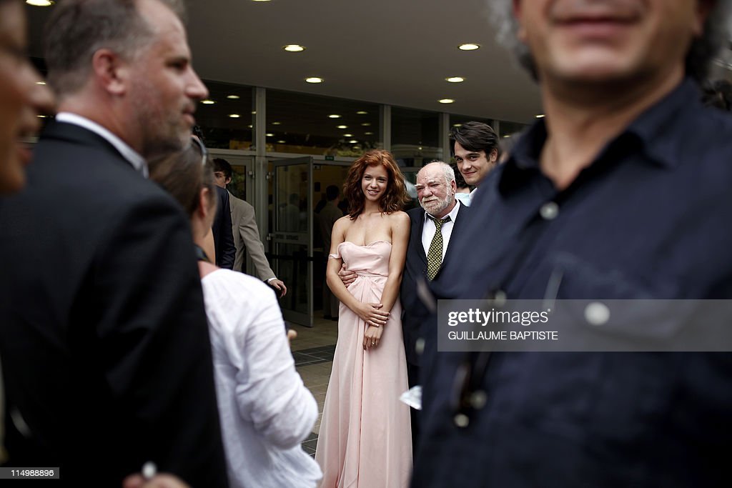 Romanian actress Ada Condeescu (L) and Romanian actor George Pistereanu (R), the actors of the film 'Loverboy' presented in the Un Certain Regard selection wait before walking on the red carpet at the 64th Cannes Film Festival on May 18, 2011 in Cannes. AFP PHOTO / GUILLAUME BAPTISTE