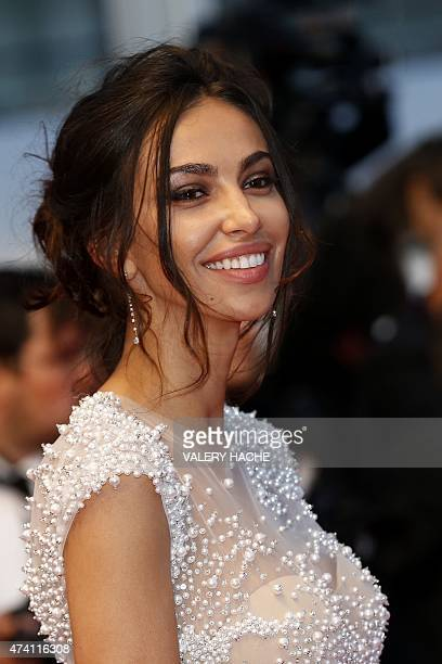 Romanian actress Madalina Ghenea smiles as she leaves the Festival palace after the screening of the film 'Youth' at the 68th Cannes Film Festival in...