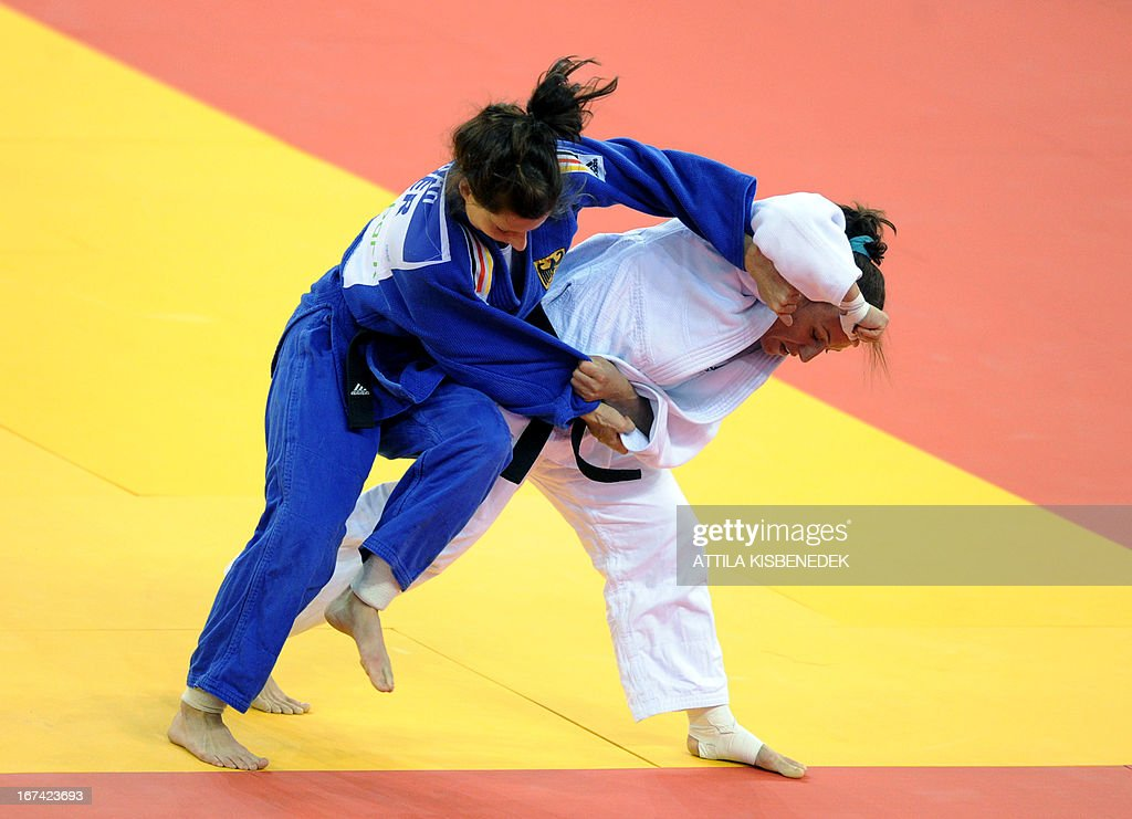 Romanian Andreea Chitu (white) fights with German Mareen Kraeh (blue) during the Judo European Championships in 66kg category for men in Budapest on April 25, 2013.