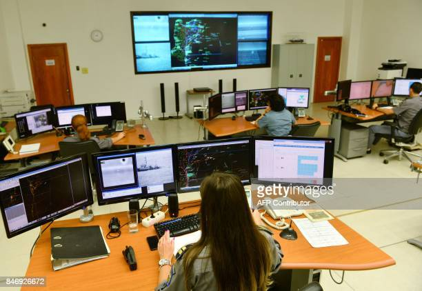 Romanian border police officers use the Integrated Black Sea Surveillance System at the Coast Guard headquarters in Constanta southeastern Romania on...