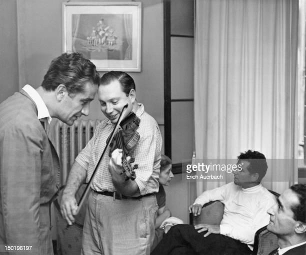 Romanian conductor Sergiu Celibidache violinist Isaac Stern and American conductor and composer Leonard Bernstein at La Fenice opera house Venice...