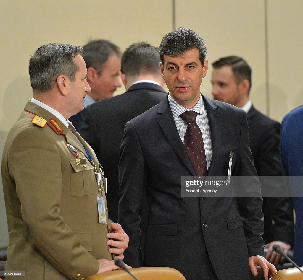 Romanian Defense Minister Mihnea Loan Motoc (R) attends the NATO Defence Ministers Meeting which is being held in Brussels, Belgium on February 11, 2016.