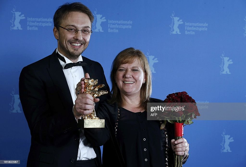 Romanian director Calin Peter Netzer and producer Ada Solomon pose backstage with the Golden Bear award for the Best Film for 'Pozitia Copilului'...
