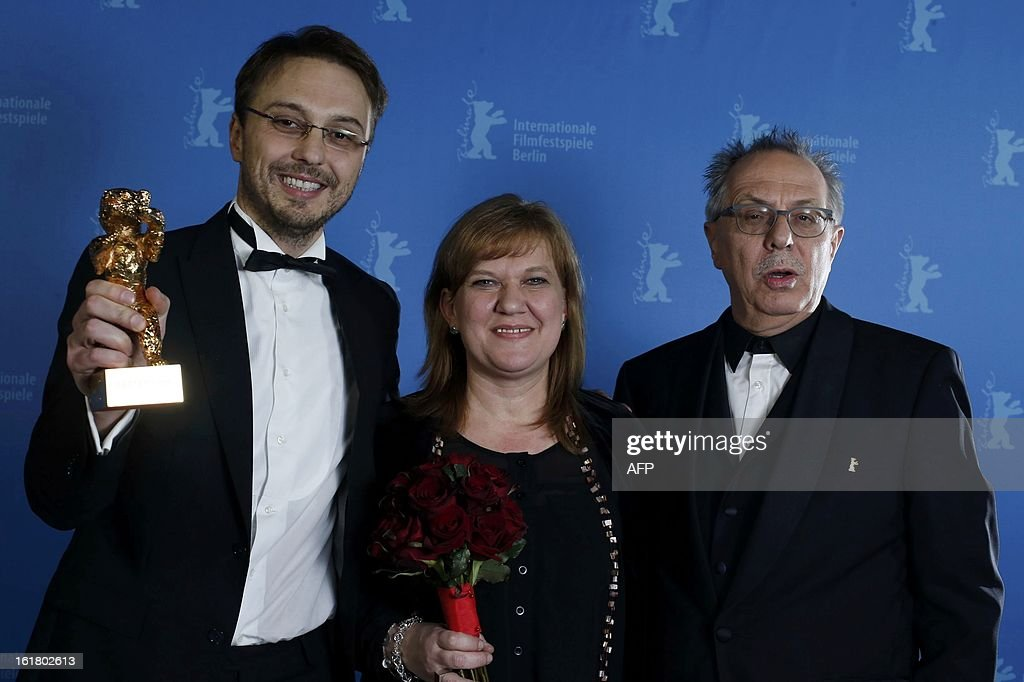 Romanian director Calin Peter Netzer and producer Ada Solomon pose with Berlinale Festival Director Dieter Kosslick backstage with the Golden Bear...