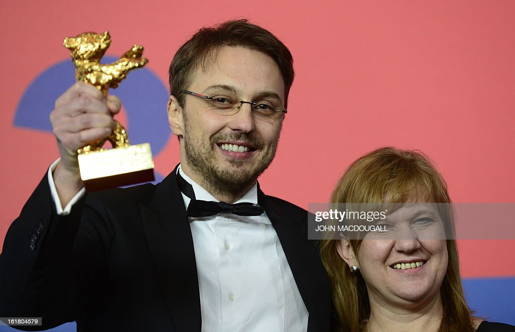 Romanian director Calin Peter Netzer and producer Ada Solomon present the Golden Bear for the Best Film they received for the movie Pozitia Copilului...