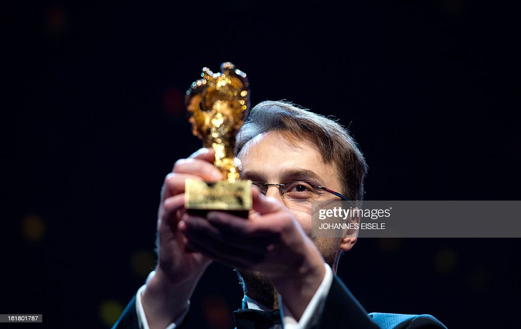 Romanian director Calin Peter Netzer receives his Golden Bear for the Best Film for his movie Pozitia Copilului during the awards ceremony of the...