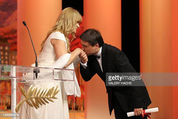 Romanian director Cristian Mungiu kisses the hand of German actress Nastassia Kinski after being awarded with the Best Screenplay award for his film...
