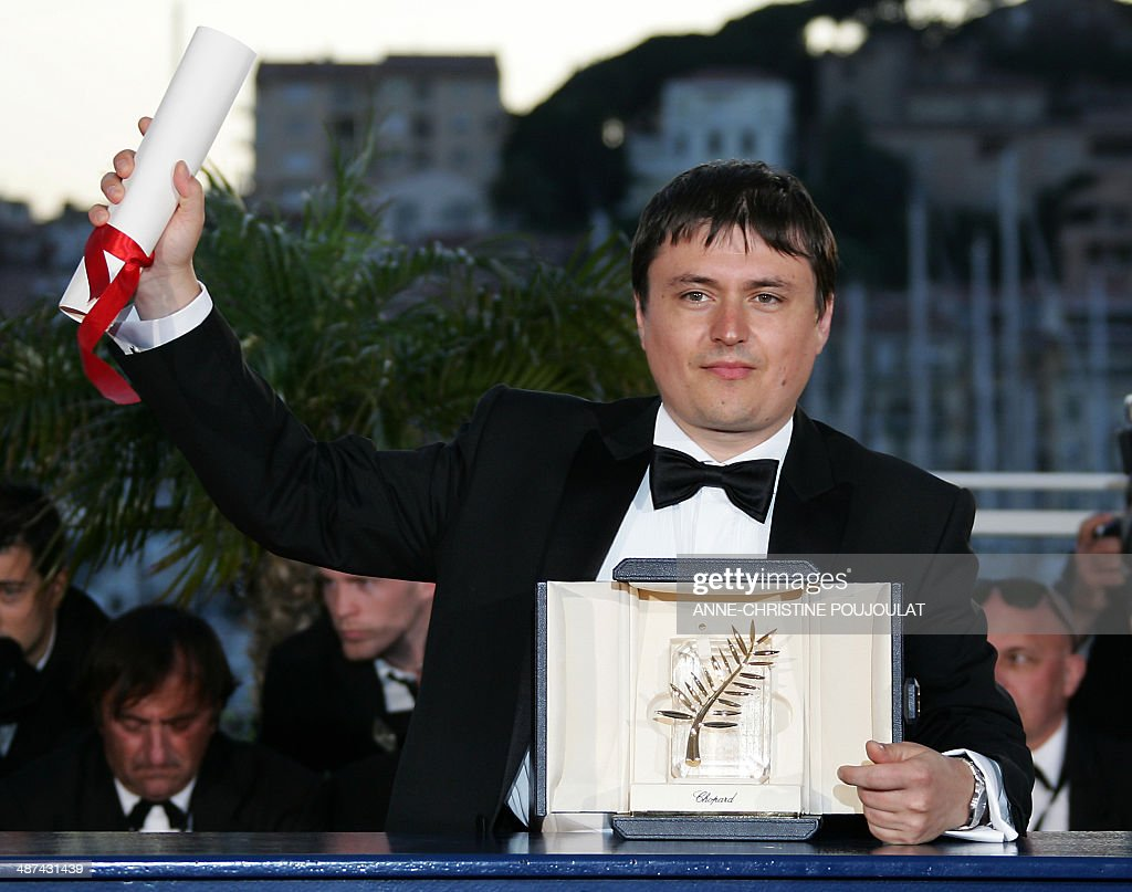 Romanian director Cristian Mungiu poses 27 May 2007 with his Palme d'Or for Best Film prize during a photocall at the 60th edition of the Cannes Film Festival at the Festival Palace in Cannes, southern France. A harrowing Romanian film won Cannes' top prize late 27 May as the world's biggest film festival brought the curtain down on a 12-day run remarkable for its star-studded brightness -- and the death-obsessed darkness of its movies. '4 Months, 3 Weeks and 2 Days' elbowed aside 21 other films to snatch the golden trophy at a glittering ceremony marking the end of the festival's 60th edition.