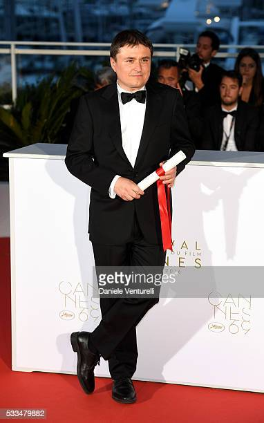 Romanian director Cristian Mungiu winner of the Best Director prize for the film 'Graduation ' poses at the Palme D'Or Winner Photocall during the...