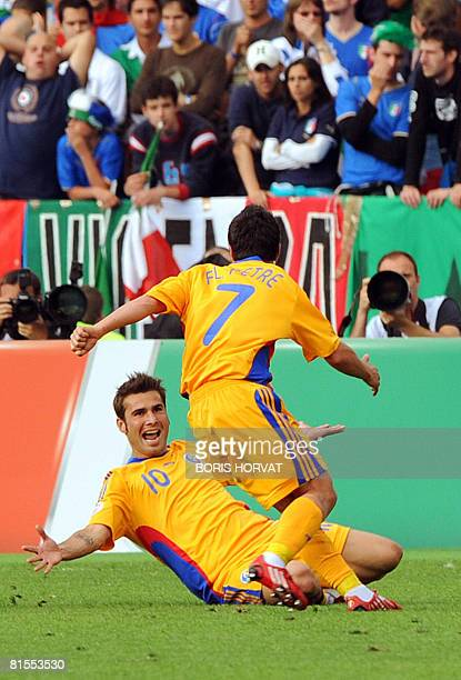 Romanian forward Adrian Mutu celebrates with mildfielder teammate Florentin Petre after scoring the opening goal against Italy during the Euro 2008...