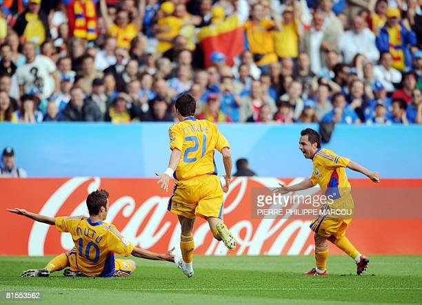 Romanian forward Adrian Mutu celebrates with teammates forward Daniel Niculae and mildfielder Florentin Petre after scoring the opening goal against...