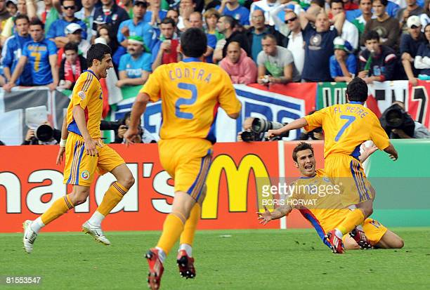 Romanian forward Adrian Mutu celebrates with teammates mildfielder Florentin Petre and forward Daniel Niculae and defender Cosmin Contra after...