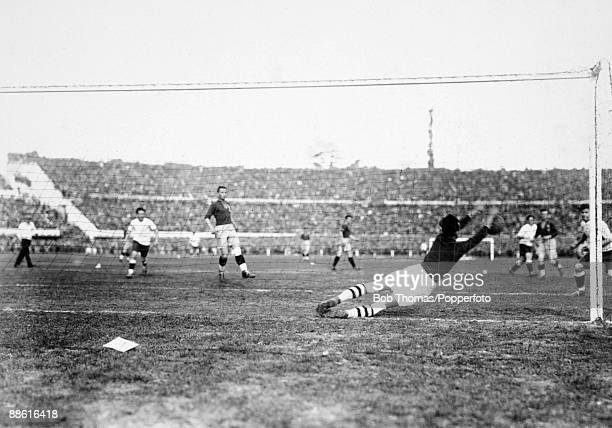 Romanian goalkeeper Ion Lapusneanu dives to make a save during the FIFA World Cup match between Uruguay and Romania at the Estadio Centenario in...