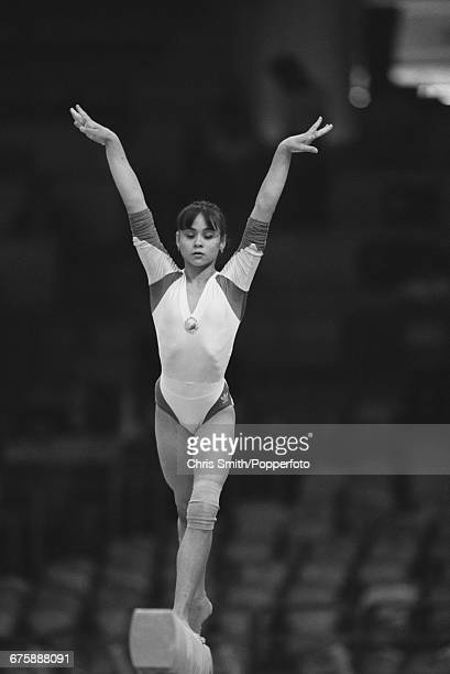 Romanian gymnast Aurelia Dobre pictured in action on the balance beam during competition to win the silver medal in the Women's artistic gymnastics...