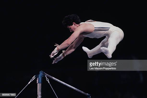 Romanian gymnast Emilian Necula pictured in action during competition in the Men's horizontal bar event at the 1984 Summer Olympics inside the Pauley...